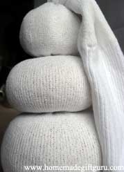 Now we see the sock snowman body and head...