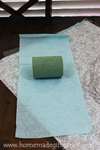 A strip of tissue paper can be used to wrap your floral foam with...