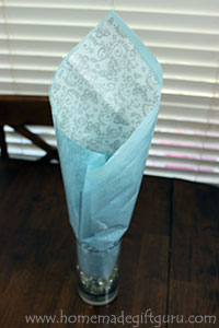 Tissue paper and cellophane provide a beautiful back drop for your chocolate candy bouquet...