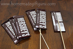 Use clear packing tape to make candy on sticks for your chocolate candy bar bouquet...