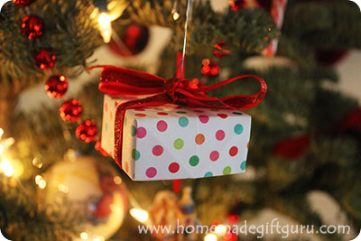 Learn how to make a countdown calendar of Christmas box ornaments that you can be hiden all over the Christmas tree to delight your kids all month long. Found at www.homemadegiftguru.com