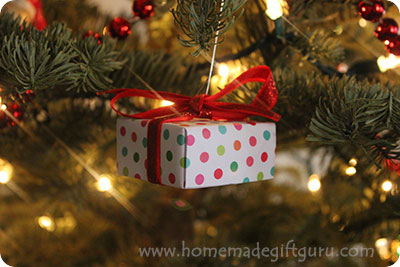 Learn how to make these fun Christmas countdown calendar ornaments using storebought or homemade gift boxes! Kids love searching for the correct numbered ornament hiding somewhere on the Christmas tree... it's like a little daily treasure hunt. www.homemadegiftguru.com