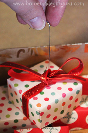 Learn how to make Christmas Countdown Calendar Ornaments using either store-bought or homemade gift boxes! Kids love this idea... They get to go on a mini-treasure hunt each day as they look for the correct countdown calendar gift box. Learn more at www.homemadegiftguru.com