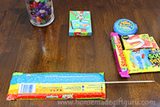For this Easter crafts, you will tape a wooden skewer to each piece of festive Easter candy.