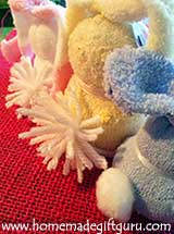 Use pom poms to make your sock bunny rabbit tails...