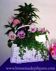 Here's a fresh flower basket arrangement that doubled as a baby shower arrangement and a gift for the mother-to-be...