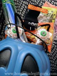 Halloween gift baskets can contain simple treats with fun decorations to make them festive...