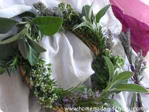 An herb wreath is the perfect way to use up fresh herbs and gift lovely fragrant garden gifts...