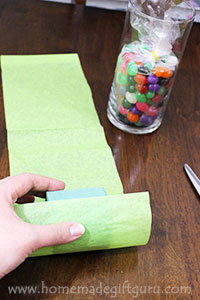 Wrap the floral foam in a strip of tissue paper to keep your Easter candy bouquet clean.