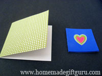 Homemade Valentines: Fold paper and center sticker on foam...
