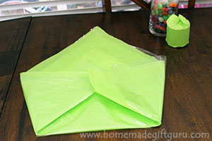 Fold the tissue paper and cellophane to make a beautiful backdrop for your Easter candy arrangement.