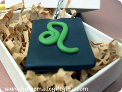 Leo symbol homemade key chain in a gift box...
