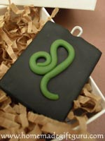 Sculpt leo symbol with rolled polymer clay...