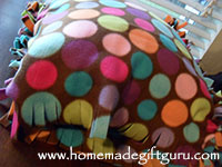 Tie the remaining strips together to complete your no sew fleece pillow cover...