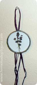 A juice lid frames this dried pressed lavender...
