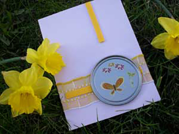 Recycled Craft Card Featuring a Frozen Juice Lid Frame