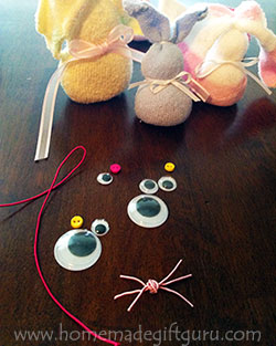 A hot glue gun will make it super quick and easy to put together a darling little sock rabbit face...