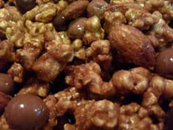 Glazed almonds and chocolate covered coffee beans put this caramel popcorn recipe over the top...