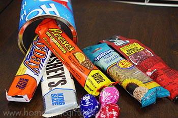 A homemade canister makes a cute homemade gift full of candy bars and snacks!