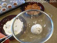 Roll powder covered truffles in a sieve to remove excess powder...