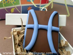 Make a Pisces symbol art charm with this polymer clay tutorial...