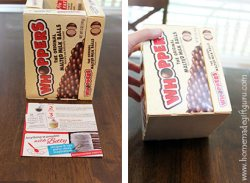 Paper board from a cereal or cake mix box works great for securing the bottom of your food gift arrangements.
