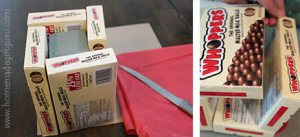 You can make a delicious vase for your snack food arrangement using movie theater style boxed candy.