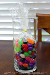 With a glass vase, you can fill it with candy for a candy from head-to-toe kind of look!
