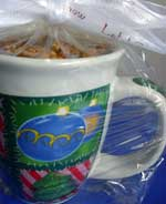 A coffee mug filled with rich and satisfying caramel latte popcorn and sealed in cellophane wrap, makes a cute homemade gift idea for co-workers, teachers and friends.