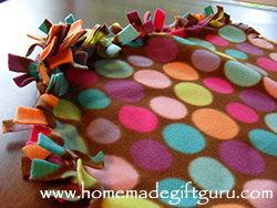 Tying the edges of your fleece pillow case project rather than sewing them closed creates a really cute fringe along the outer edges of your homemade pillow.