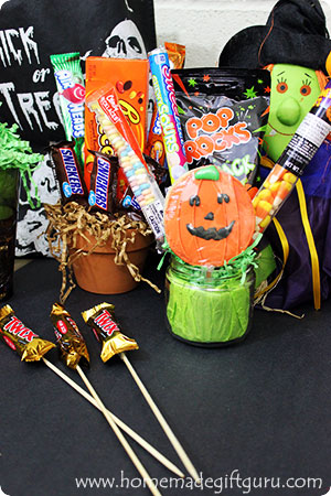 You can use just about any jar, cup, tin, pot or vase you can think of to make your own unique Halloween candy arrangements. Click through for tips and tricks!
