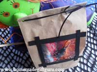 This DIY Halloween party bag idea starts with a simple brown paper lunch bag. It also makes a unique homemade gift bag for giving homemade Halloween gifts and homemade Halloween treats.
