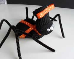 Dress your sock spider up however you choose. Use ribbon, flannel for a scarf or keep it simple. These guys will be cute no matter what.