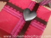 Heart charm decorates homemade origami Masu box.