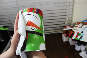 Smooth out the gift bag, using a cloth is helpful.