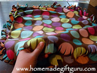 After tying off three of the four sides, it's time to fill your adorable fleece pillow cover with a pillow base or with fiberfill.