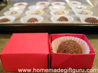 Homemade truffles look elegant and scrumptious nestled inside homemade origami boxes.