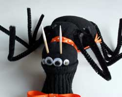 Paint two toothpicks white and allow them to dry. These will be the cute and SCARY teeth of your Halloween sock spider.