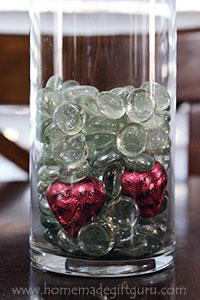 Chocolate hearts snuck in amongst the glass beads is a cute candy bouquet idea...