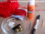 Decorate your snowman with ribbon, buttons, bells, black sharpie for eyes and mouth and orange toothpick for nose.