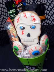 Flashlights, glow sticks and safety whistles make great Trick-or-Treat themed gift basket ideas. A new pair of Halloween PJs can be used to line Halloween gift baskets and makes a great tradition!