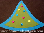 Multi-colored beads are used to look like Christmas ornaments on this tree-shaped gift tag.
