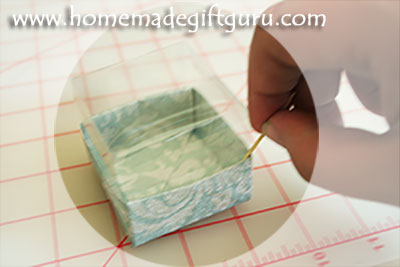Tip... use a toothpick to flatten the flaps inside the handmade gift box.