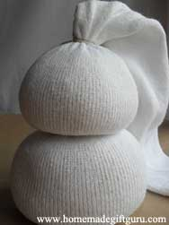 First make the body of your sock snowman. Rice makes a great filler but you can use dried beans if you prefer.