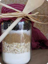 Classic old fashioned homemade cookie mix in a jar gift with wooden spoon