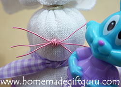 Sock Craft Tutorial: Memory wire makes a cute nose with whiskers.